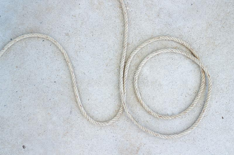 Marine Rope spiral on concrete floor at boat station in Koh Mak in Trat, Thailand.  royalty free stock photography