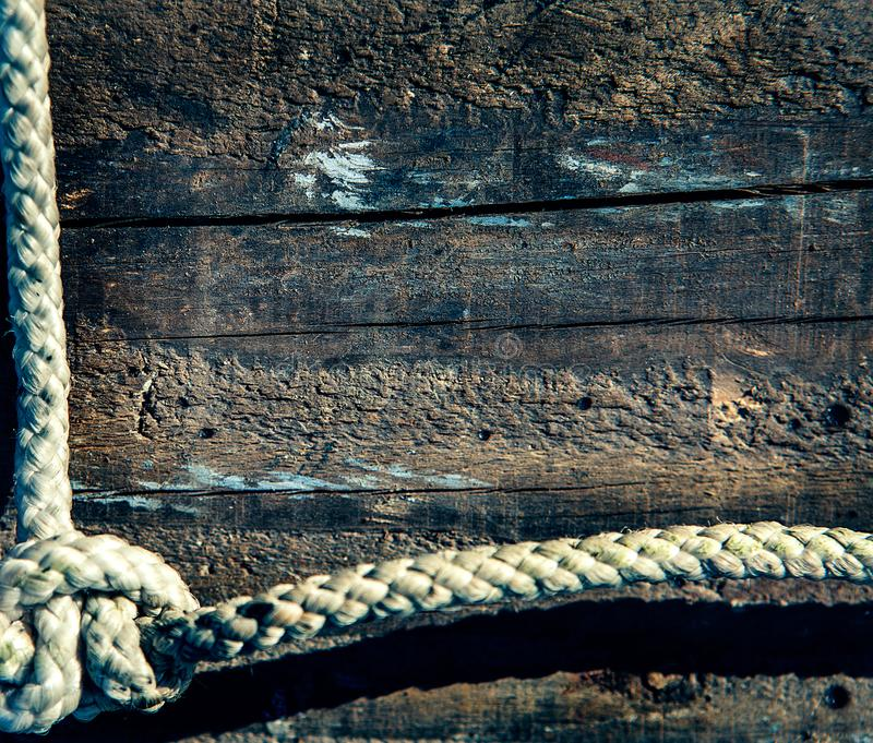 Marine Rope On Weathered Old Wood Background Stock Image - Image of