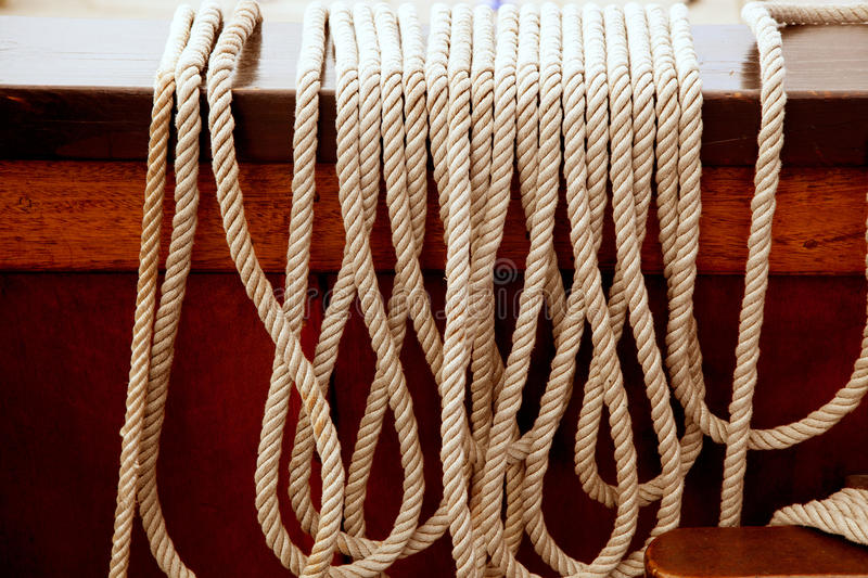 Marine ropes in a row on vintage wooden boat royalty free stock image