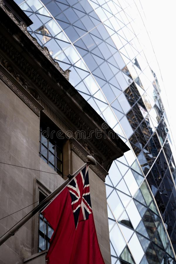 Marine sea red ensign flag at the Baltic Exchange building, 38 St Mary Axe stock images