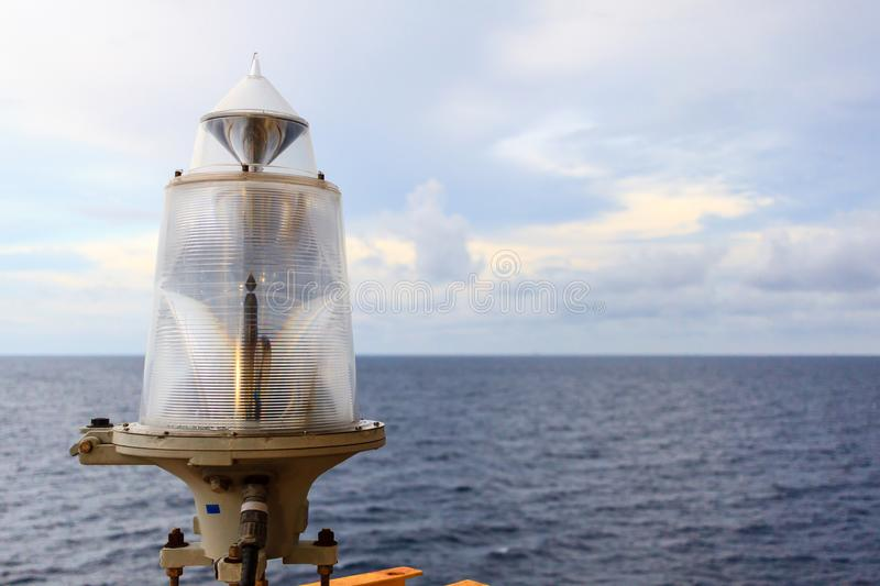 Marine signal lantern Navigator aid. Marine signal lantern Navigator aid for notified construction in the sea at night time on offshore oil and gas operation stock image