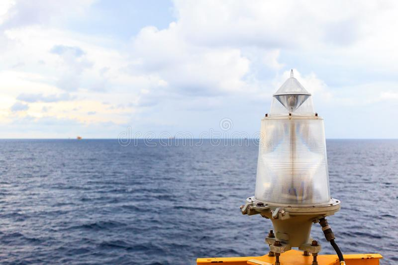 Marine signal lantern Navigator aid. Marine signal lantern Navigator aid for notifier construction in the sea at night time on offshore oil and gas platform royalty free stock images
