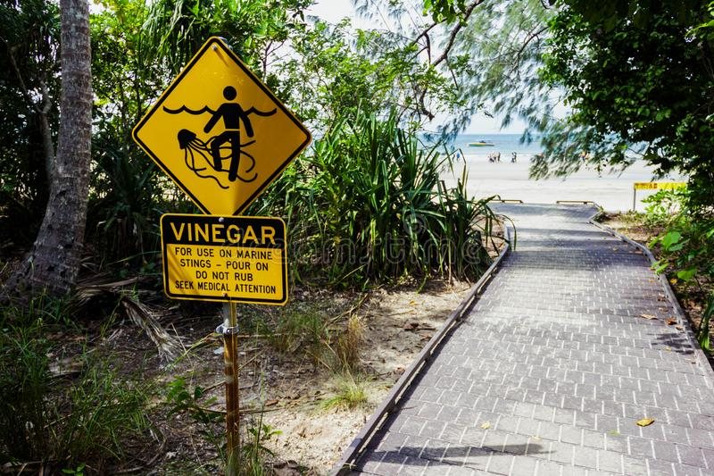 Marine Stinger Sign and Vinegar bottle. In case you get stung by them. Australia, symbol, wild, burn, nature, tentacle, venom, caution, blue, safety, drawing royalty free stock images