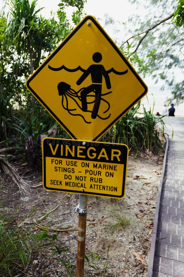 Marine Stinger Sign and Vinegar bottle. In case you get stung by them. Australia, symbol, wild, burn, nature, tentacle, venom, caution, blue, safety, drawing royalty free stock photography