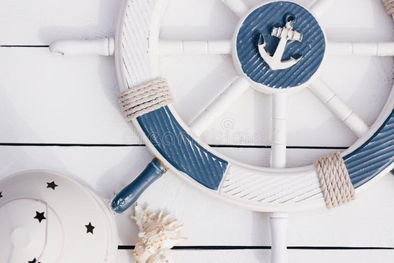 Marine style postcard. Marine rudder on a white wooden background. Vintage. Travel theme stock photo