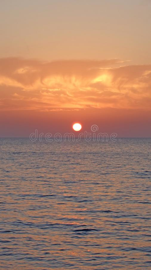 Marine sunset, clouds over the sea stock photo