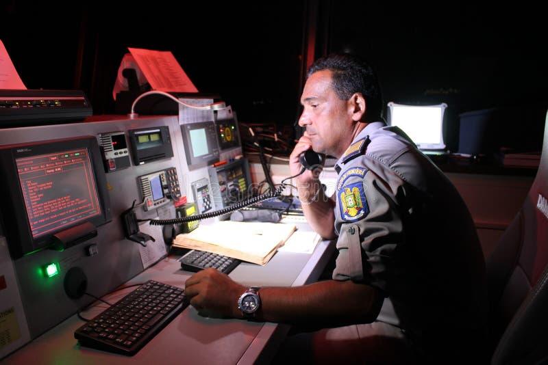 Marinepolitieman op boot royalty-vrije stock foto's