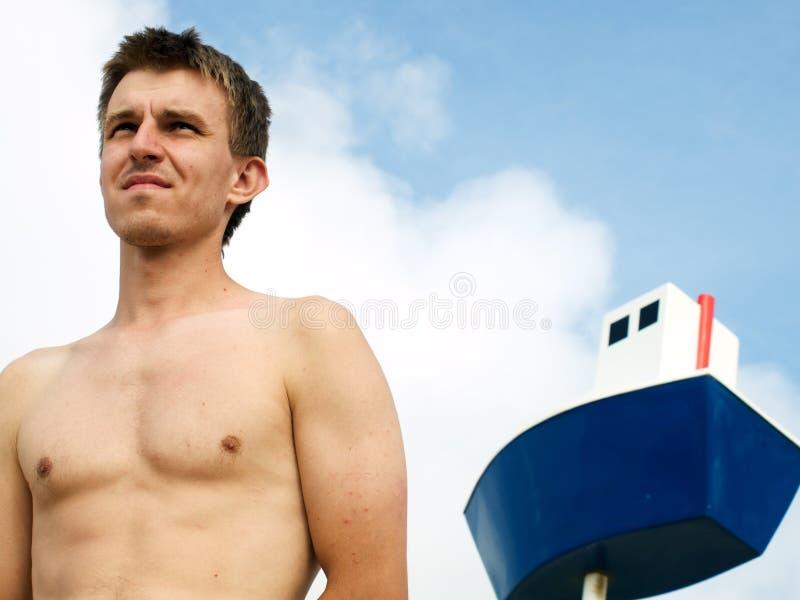 Marinheiro e o navio foto de stock