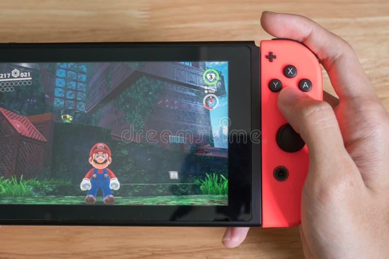 Mario Odyssey super no interruptor de Nintendo imagens de stock royalty free