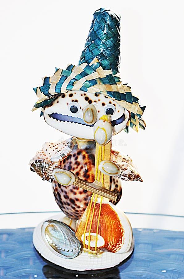 Marionet van zeeschelpen wordt gemaakt die stock illustratie