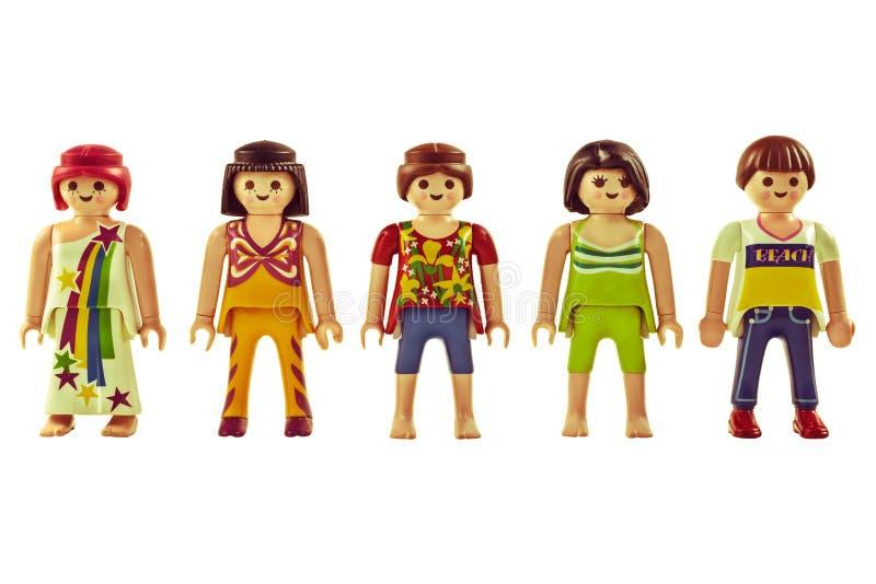 Marionetas de Playmobil del vintage con la ropa del flower power aislada encendido fotos de archivo