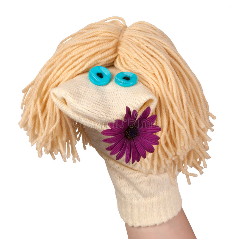 Marionnette de chaussette avec une fleur images stock