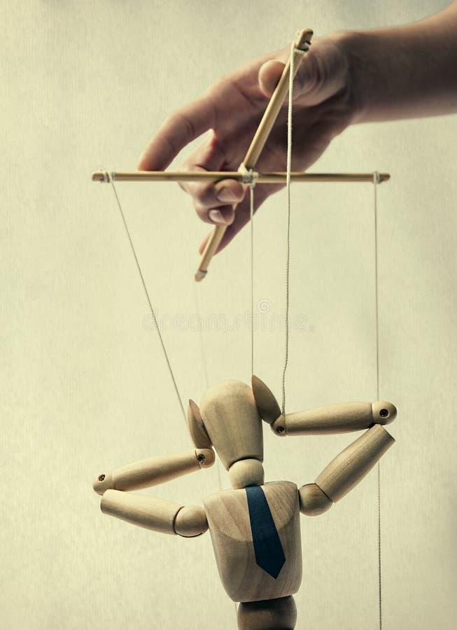 Marionnette sur une chaîne de caractères photographie stock libre de droits