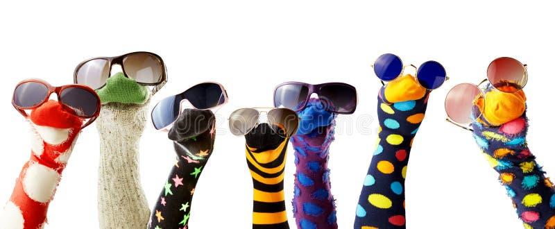 Marionnettes de chaussette portant des lunettes photo libre de droits