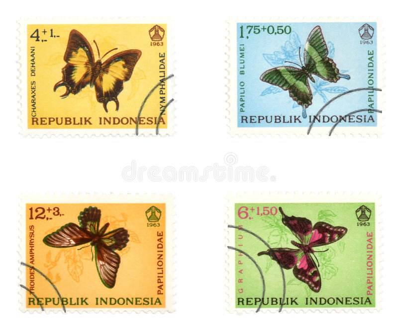 Mariposas coloridas en sellos del poste foto de archivo