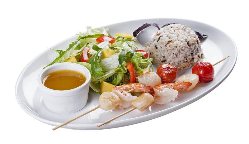 Marisco com arroz e vegetais foto de stock