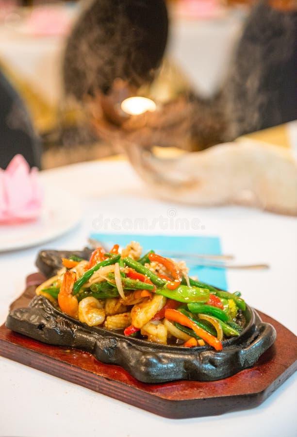 Marisco crepitante do estilo tailandês imagens de stock