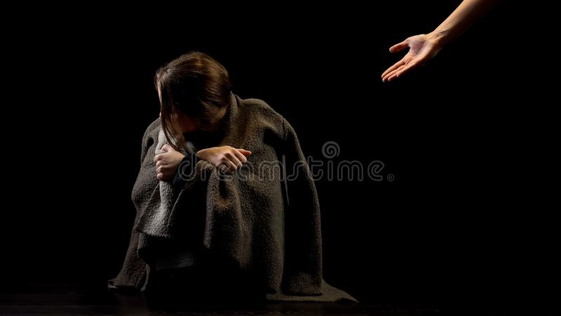 Marital abuse victim rejecting helping hand, disbelief in future happiness. Stock photo royalty free stock images