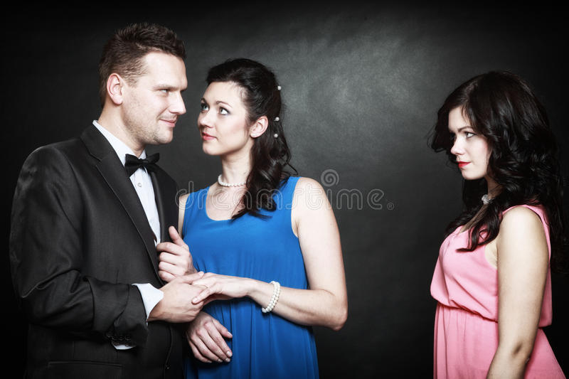 Marital infidelity concept. Love triangle passion hate. Marital infidelity concept. Love triangle two women one men passion of love hate. Mistress betrayal stock photo