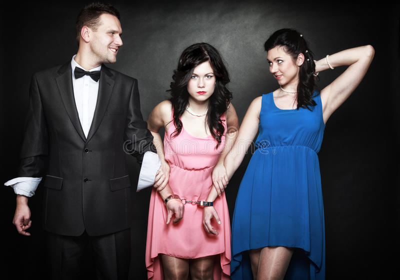 Marital infidelity. Love triangle passion hate. Marital infidelity concept. Love triangle two women one men passion of love hate. Mistress betrayal within the stock image