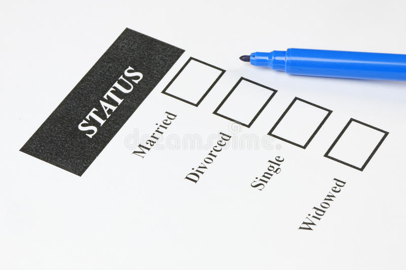Marital Status Form. Form showing marital status with check - boxes and pen royalty free stock photos