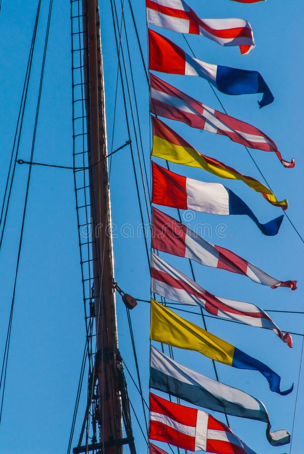 Maritime colorful signal flags. Maritime signal flags on ship mast in hamburg Hafen-Geburtstag royalty free stock photos