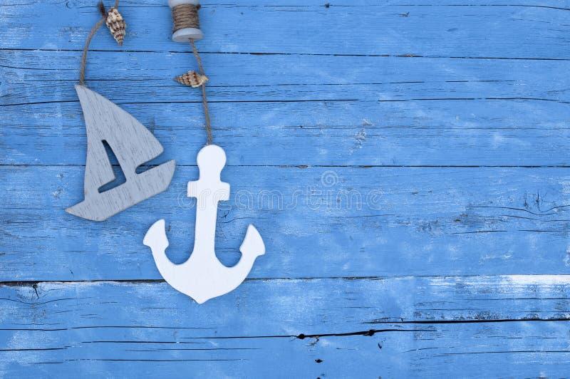 Maritime Decoration with shells, starfish, sailing ship, fishing net on blue drift wood stock photos