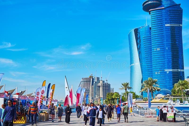 The maritime exhibition in Doha, Qatar. DOHA, QATAR - FEBRUARY 13, 2018: The crowded yacht fair is timed to the Day of Sport and held next to Sheraton Park in Al royalty free stock image