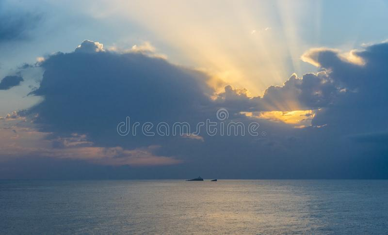 Maritime landscape at sunrise in the Mediterranean Sea with the lighthouse on. Murcia, Spain stock photos