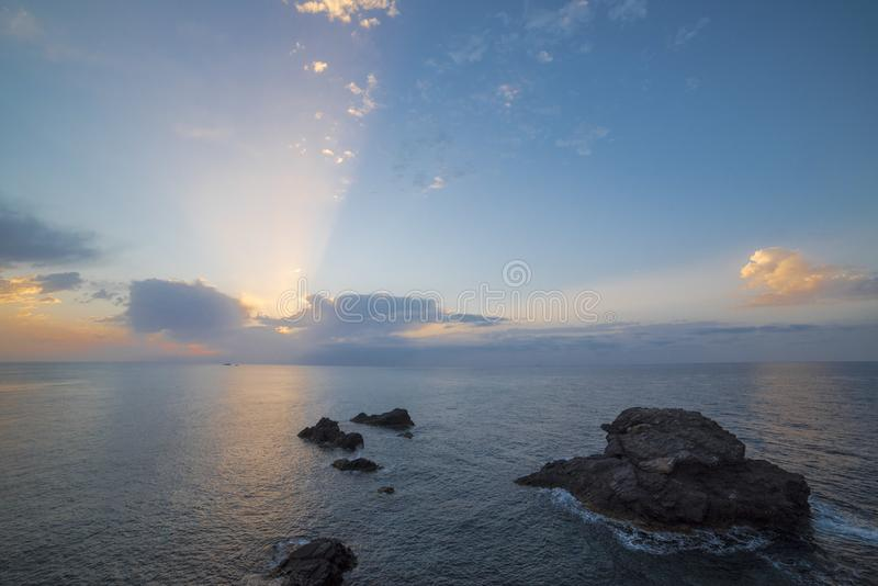 Maritime landscape at sunrise in the Mediterranean Sea with the lighthouse on. Murcia, Spain royalty free stock photos
