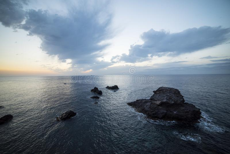 Maritime landscape at sunrise in the Mediterranean Sea with the lighthouse on. Murcia, Spain royalty free stock photo