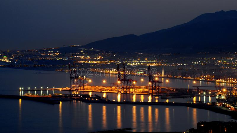Maritime port of Malaga Spain at night with the city of Malaga in the background stock images