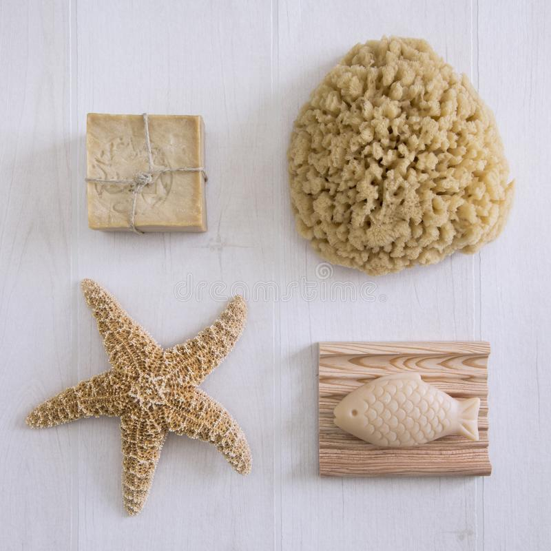 Maritime Still Life. Maritime spa still life with natural sponge, starfish and soap royalty free stock photos