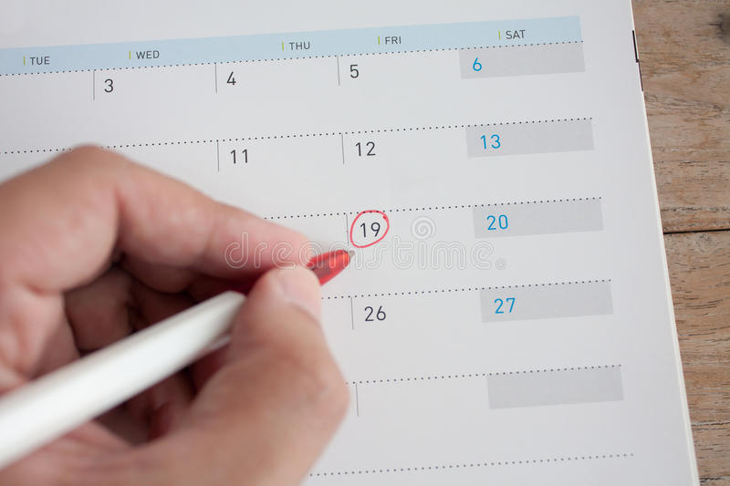 Mark on the calendar. Red circle mark on the calendar royalty free stock images