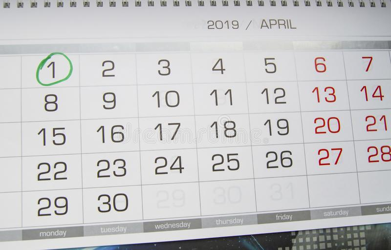 Mark a circle on the calendar date of April 1, the feast of fool`s Day, laugh, humor, jokes.  stock photo