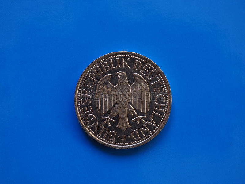 1 mark coin, Germany over blue. 1 mark coin money DEM, currency of Germany over blue background stock image