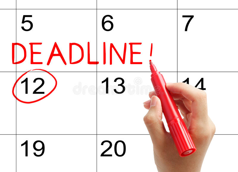 Mark the deadline on the calendar. With red marker stock images
