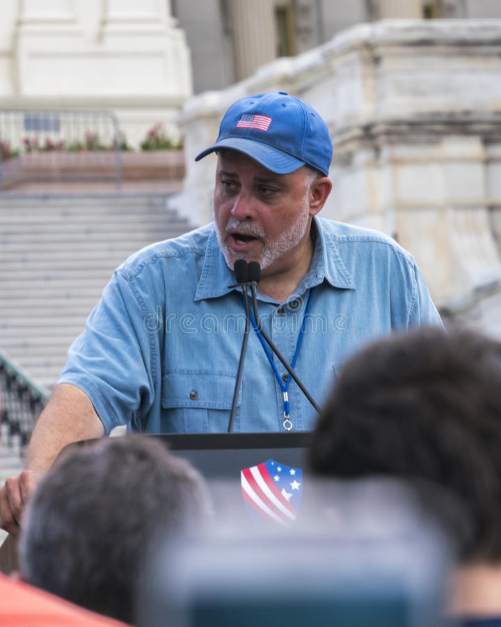 Mark Levin Addresses Crowd Protesting Iran Deal at U.S. Capitol. Conservative radio talk show host Mark Levin addresses large crowd gathered at the U.S. Capitol royalty free stock image