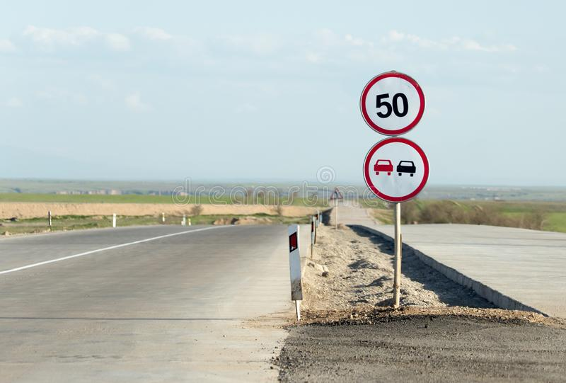 Mark overtaking is forbidden on the road.  stock images