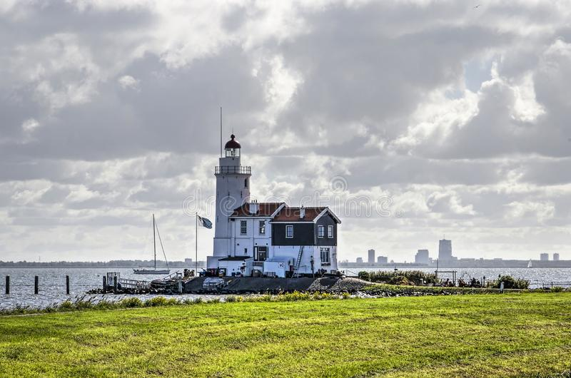 Lighthouse, clouds and skyline royalty free stock photo