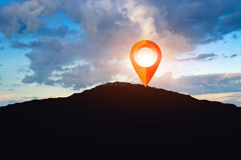 Marker navigation point on top of the mountain, sunset sky with. Sun collage royalty free stock photos