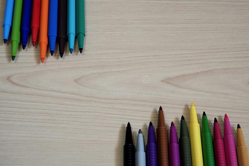 Marker Pens on wooden table background. Colorful water Marker Pens put on wooden table background with space for using royalty free stock images