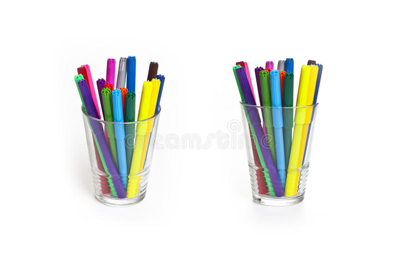 Markers in a cup markers in a cup. On a white background stock images