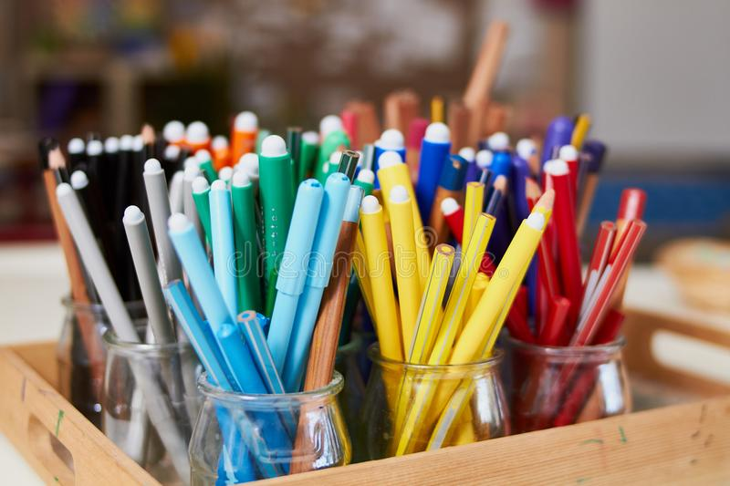 Markers set in glass cups. For school learning stock images