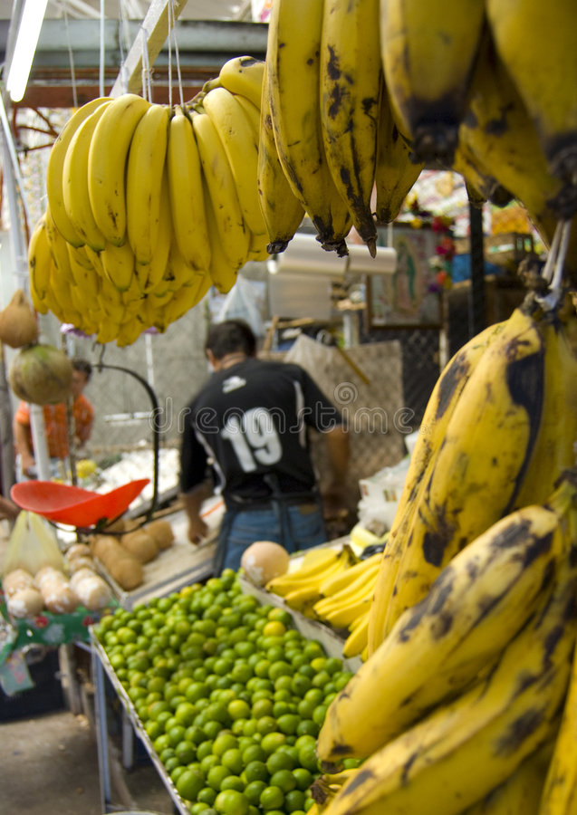 Market. A small fruit stand inside a farmers market in a rural area of Mexico. bananas stock image