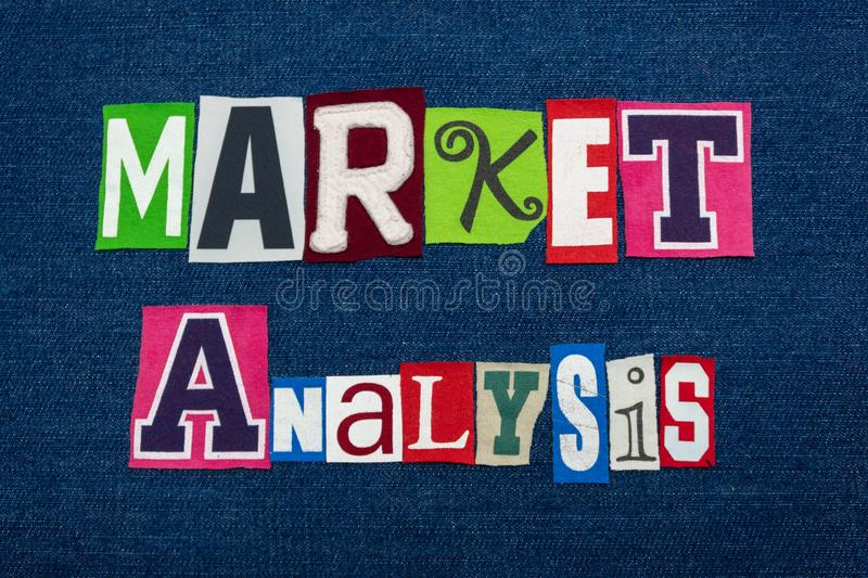 MARKET ANALYSIS text word collage, multi colored fabric on blue denim, trends examination concept. Horizontal aspect royalty free stock photos