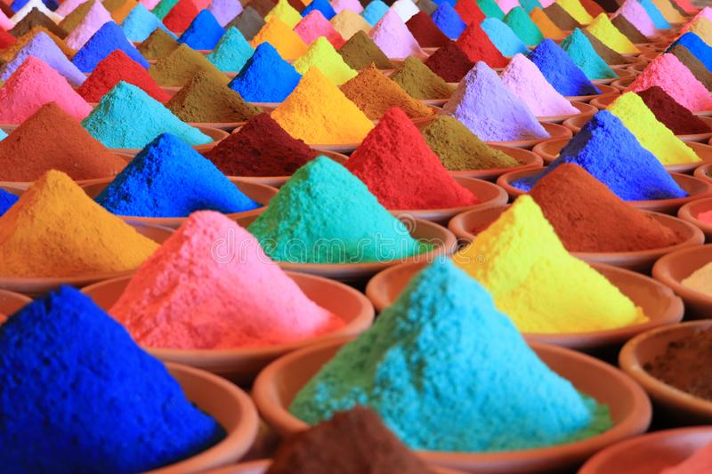 Various spices selection. multicolored powder dyes in a market stock image