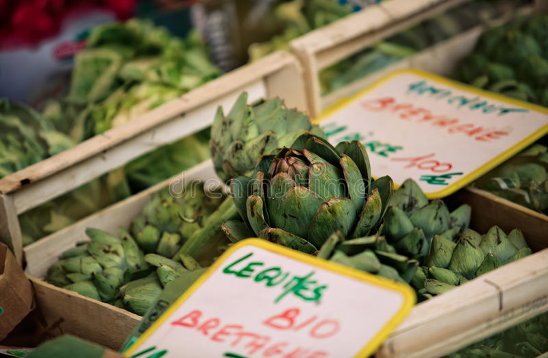 Market in Brittany France. Artichokes at a local Weekly Market in Brittany France stock photos