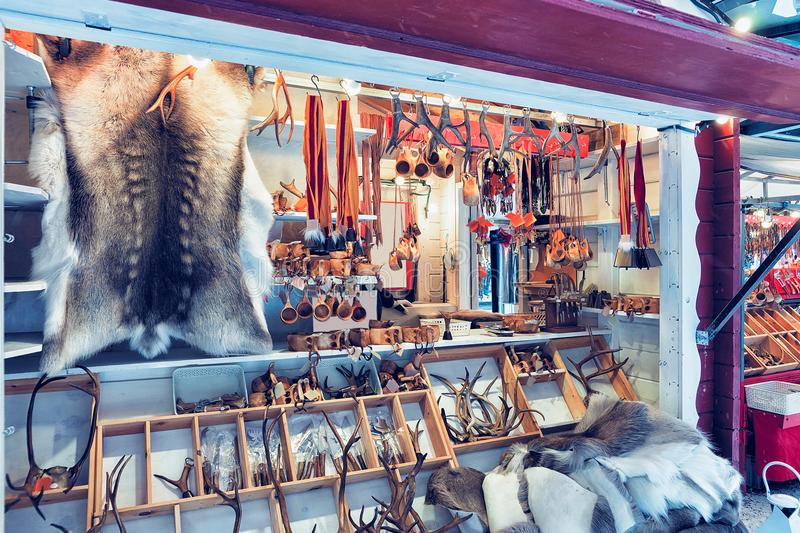 Market counter with reindeer skin and horns in winter Rovaniemi stock image