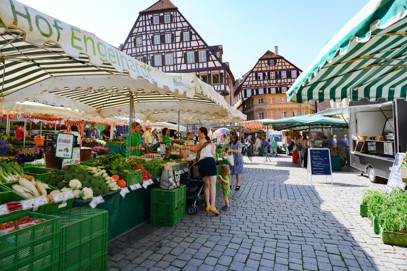 Weekly market in front of ancient historic houses, half timbered houses of Schwabisch Hall, Baden-Wuerttemberg, Germany. stock photo